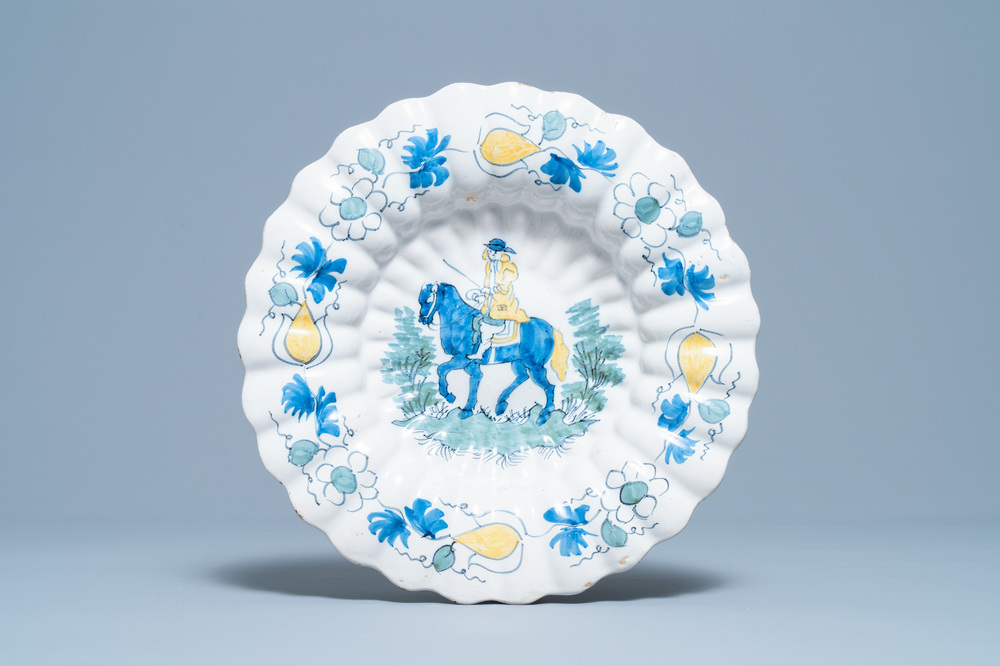 A polychrome Dutch Delft gadrooned dish with a horse rider, late 17th C.