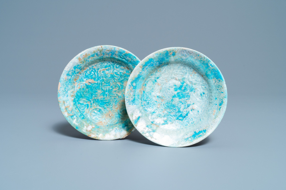 A pair of turquoise-glazed relief-decorated plates, Raqqa, Syria, 13/14th C.