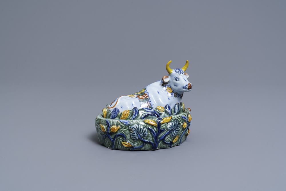 A polychrome Dutch Delft butter tub in the shape of a cow, 18th C.