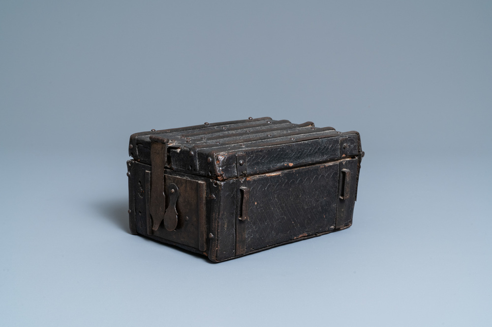 A chiseled leather-clad wooden travel casket, France, 15th C.
