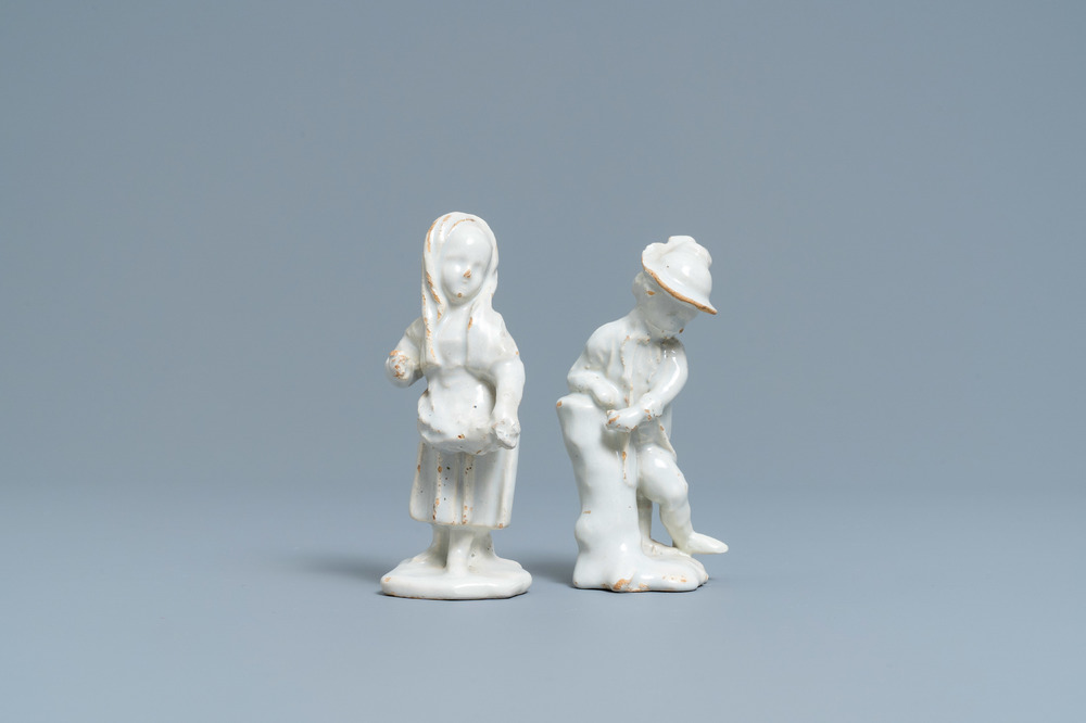 Two white Dutch Delftware figures of a boy and a girl, 18th C.