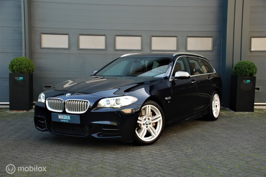 BMW 5-serie Touring M550xd Dealer