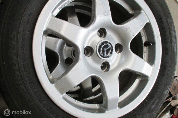 Lichtmetalen velgen origineel set lichtmetaal Mazda 323 Fastbreak 1.5i GLS ('98-'03)