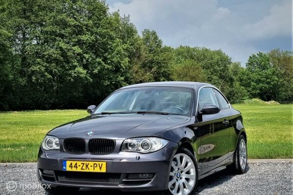 BMW 1-serie Coupé 120d High Executive, Leer, Airco, Cruise.