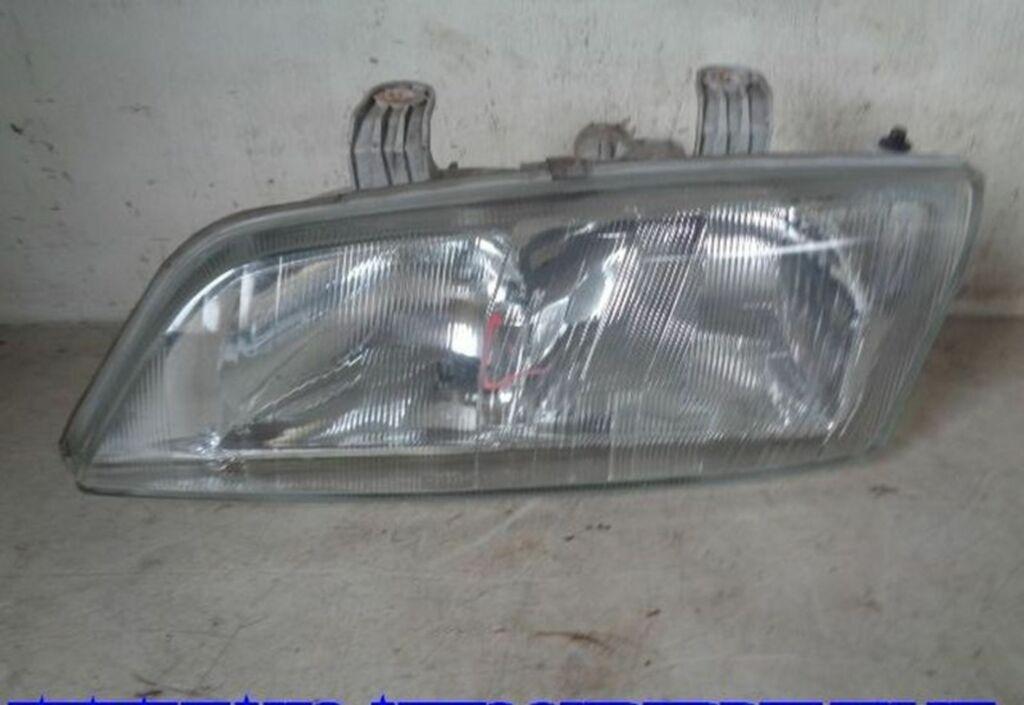 Koplamp L Nissan Primera Estate I 2.0 SLX                       082151172L