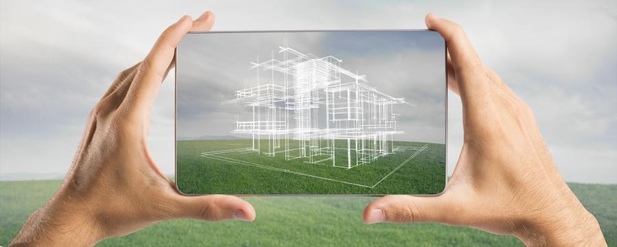 Symbolische Hausbaupläne in Tablet dargestellt