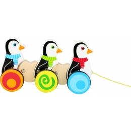 Pinguinii dansatori, jucarie de tras din lemn