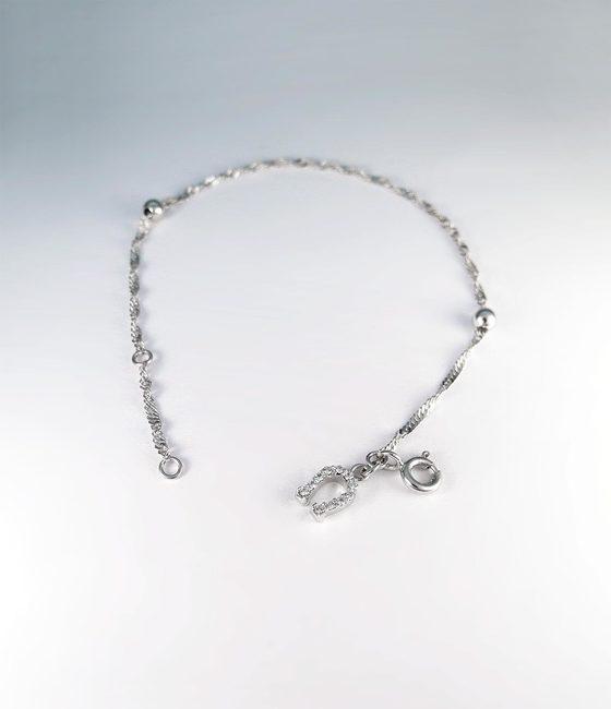 bracelet minimal avec sphères pendentif fer à cheval or blanc massif