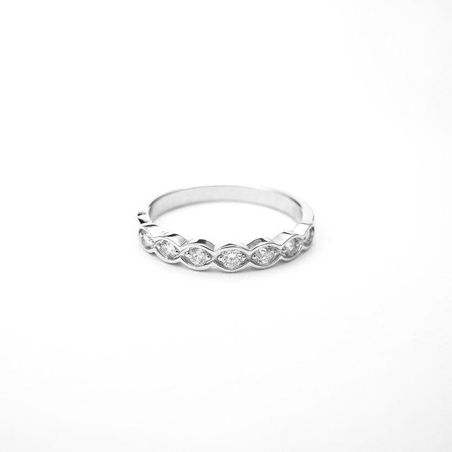 poročni prstan vijugast zlato diamanti
