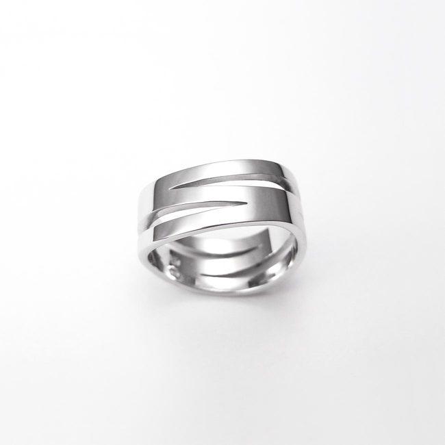 poročni prstan prepletajoce linije