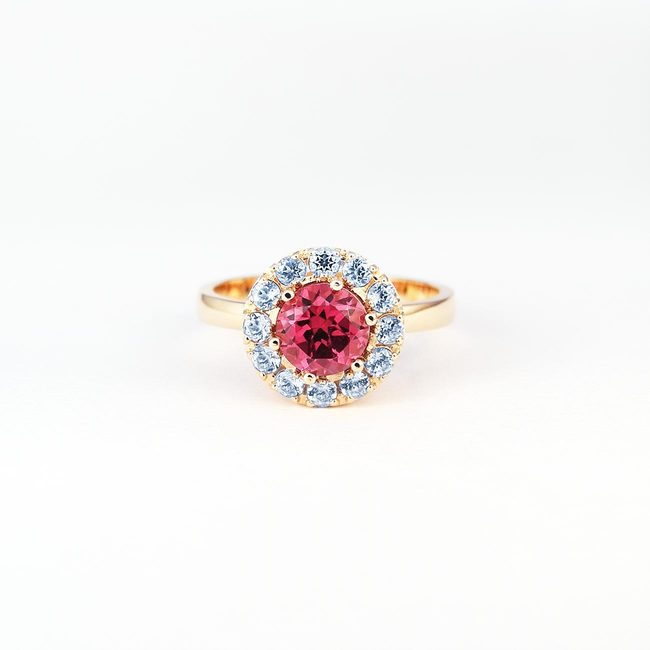 rose gold ring with rhodolite and lite blue topaz