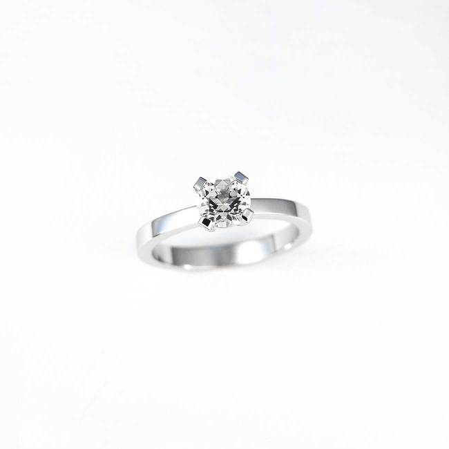 solitaire engagement ring with white diamond stone