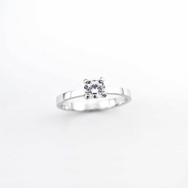 classic engagement ring with white smaller stone