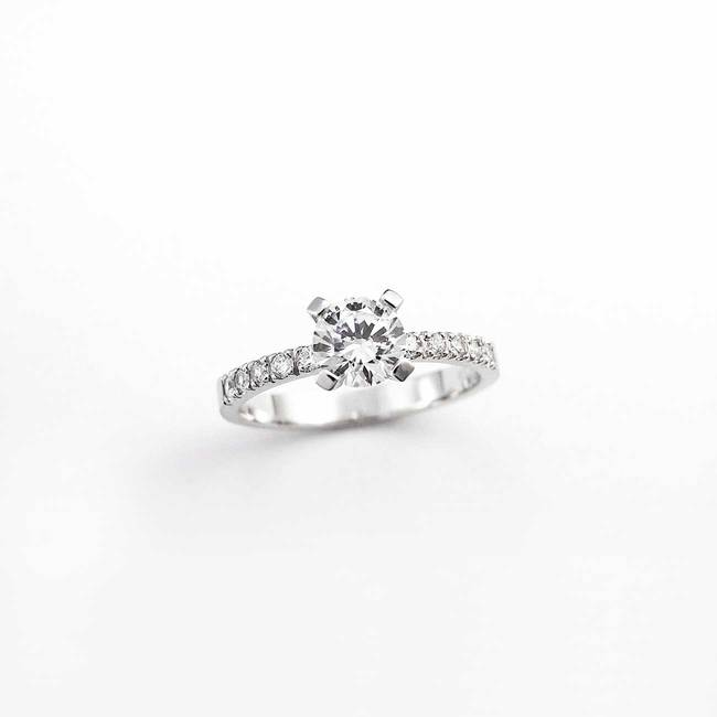 engagement ring with main stone and smaller stones on the sides