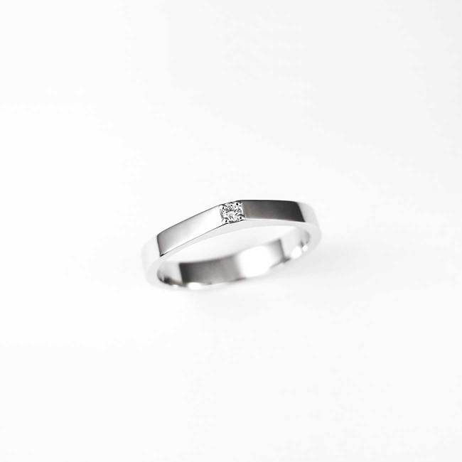 minimal engagement ring with diamond stone