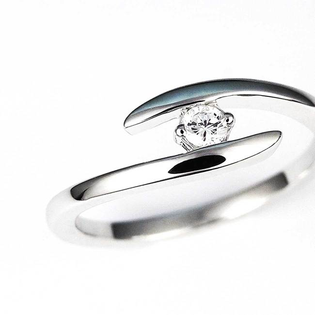 ring thin curved diamond stone closeup