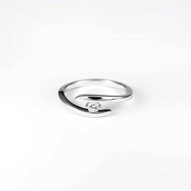 simple engagement ring curved thin diamond