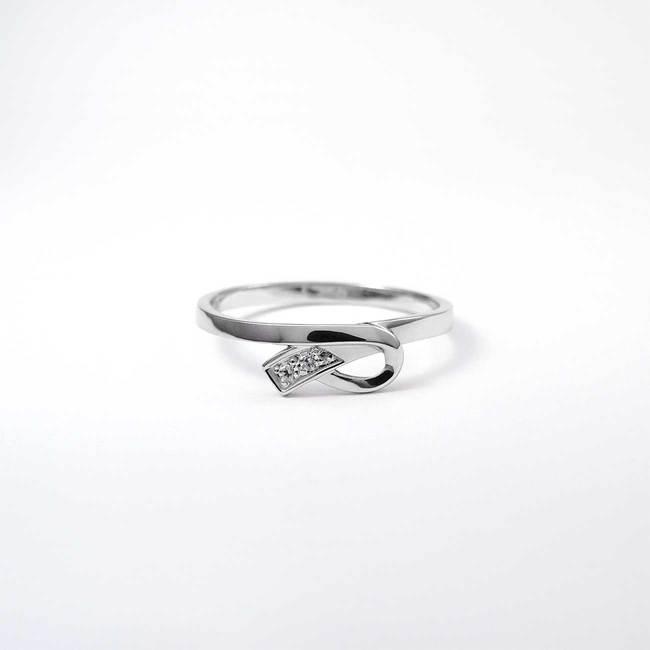prstan belo zlato diamanti všečna pentlja