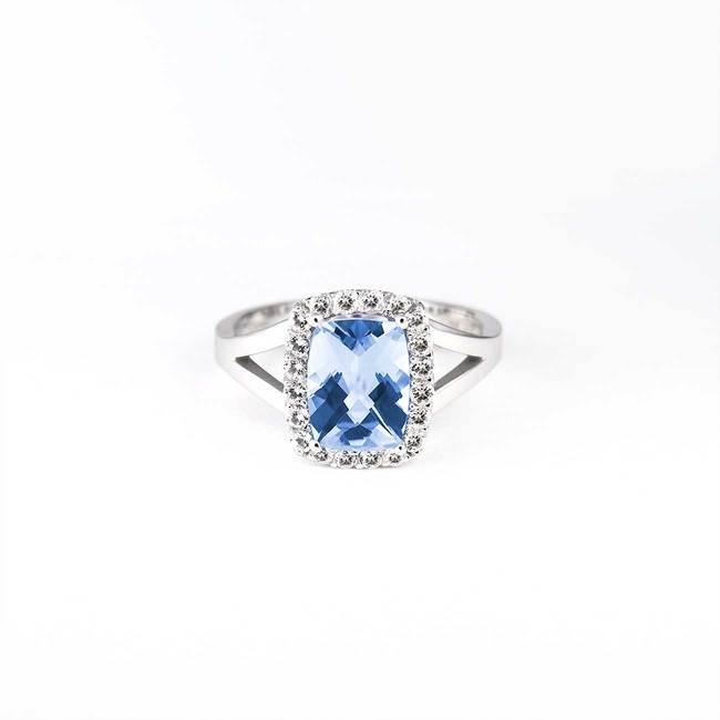 verlovingsring blauwe topaas diamanten halo