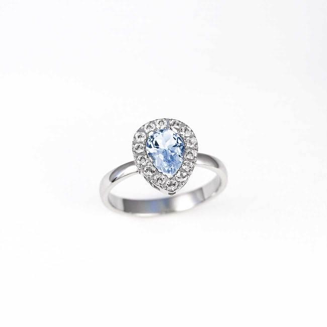 bogat zaročni prstan s topazi in diamanti