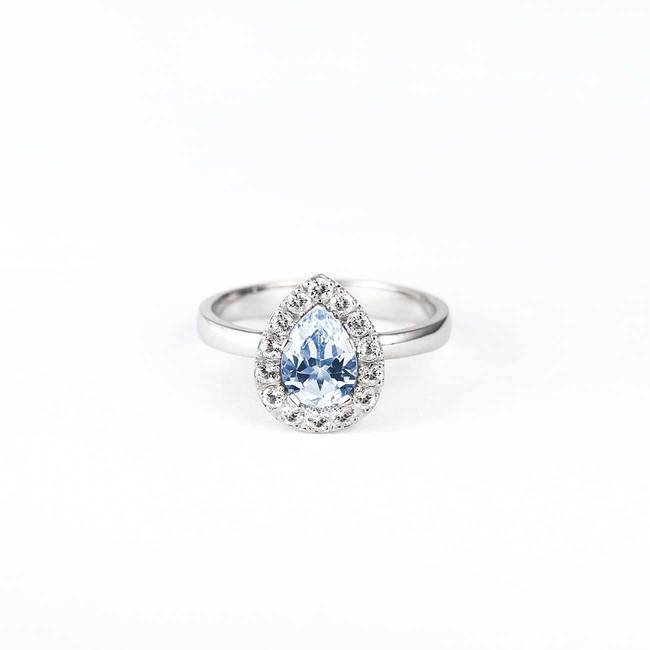halo engagement ring with topaz and diamond stones