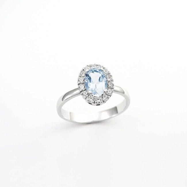 zaročni prstan ovalni veliko kamnov belo zlato cirkoni topaz