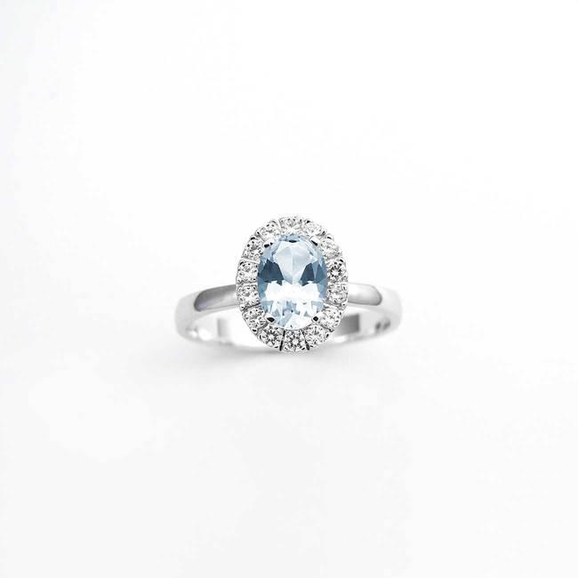zaročni prstan ovalni veliko kamnov belo zlato cirkoni modri topaz