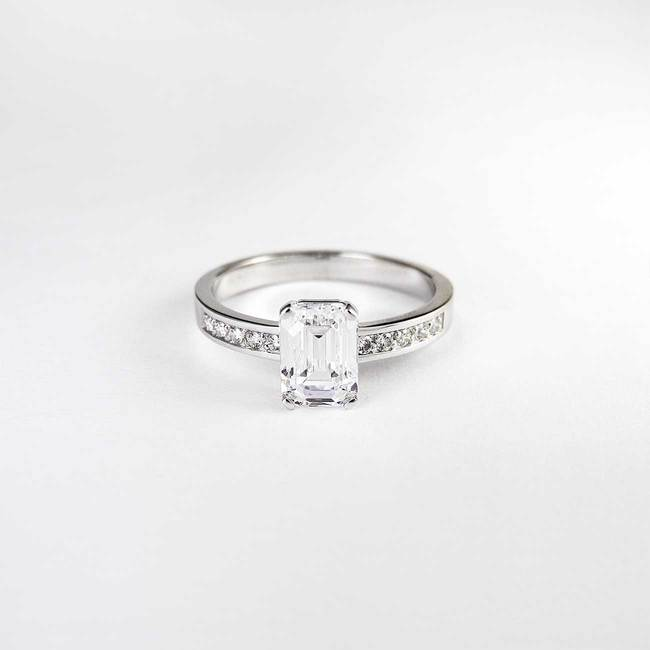 emerald cut engagement ring modern design with side stones