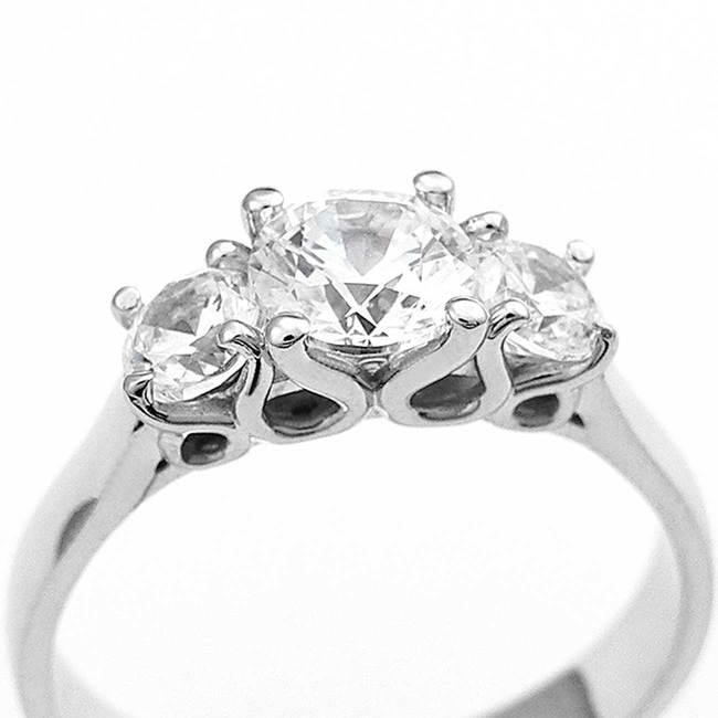 modern engagement ring three stone design different stones closeup