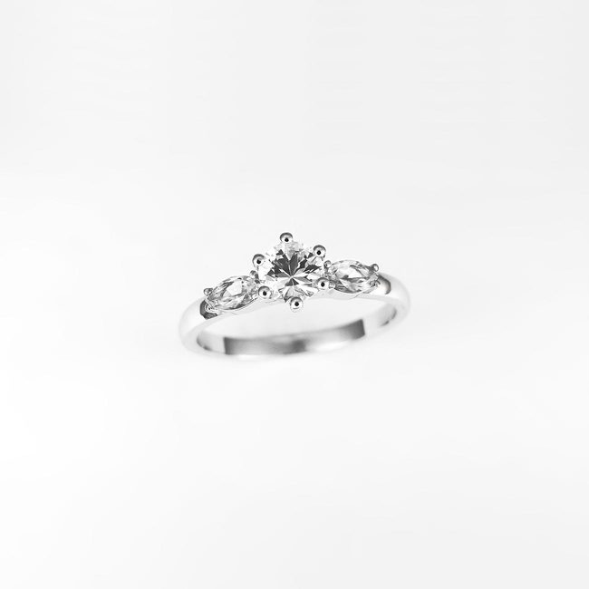 engagement ring round side marquise stone