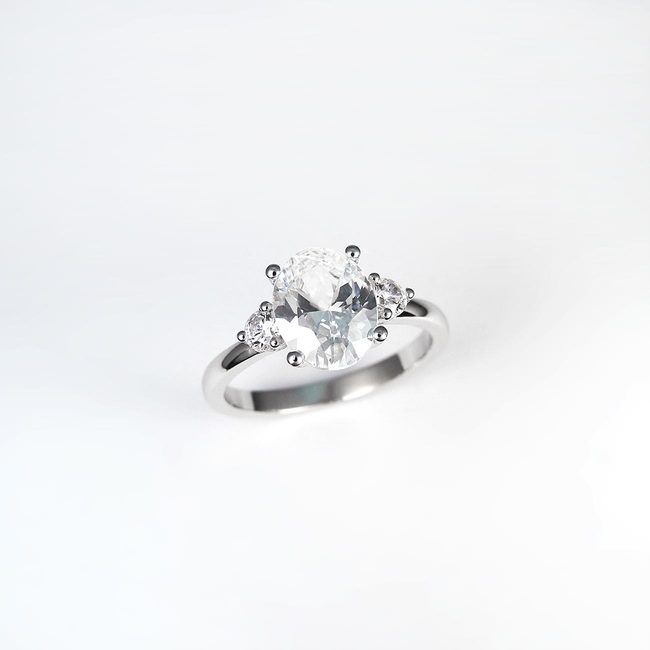 engagement ring with oval stone and side stones