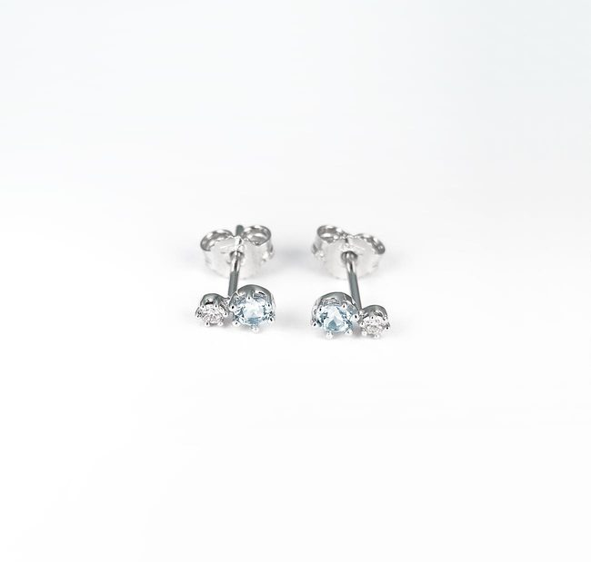 stud earrings light blue topaz diamonds