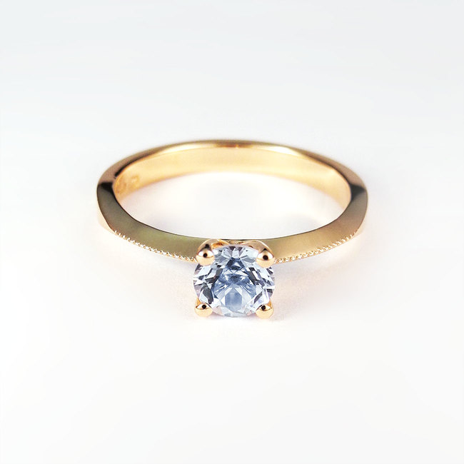 rose gold blue topaz millgrain ring engagement