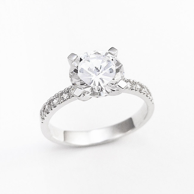 classic ring with central round stone side diamonds engagement