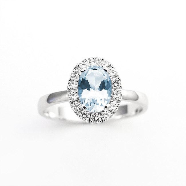 zaročni prstan ovalni belo zlato cirkoni diamanti poldragi kamni veliko moder topaz