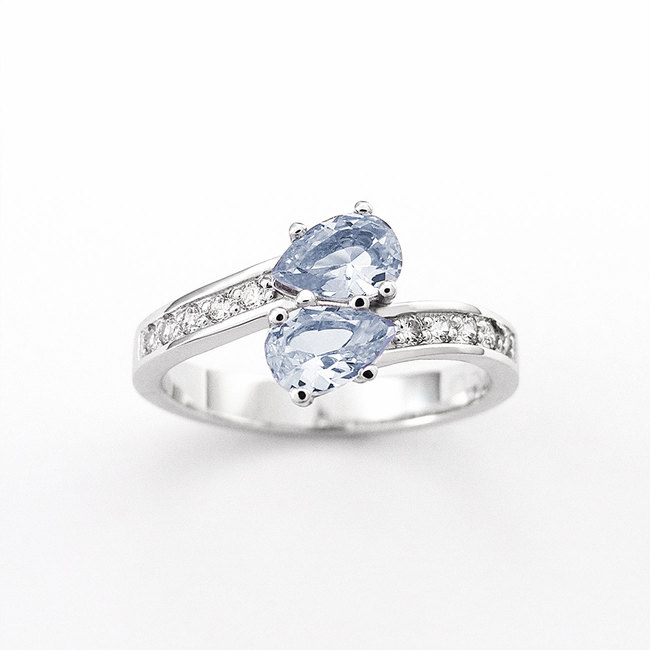 engagement ring side curved with diamonds pear semiprecious stone blue topaz white gold