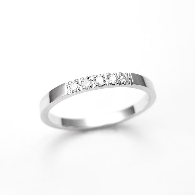 thin minimalist engagement ring with white diamonds