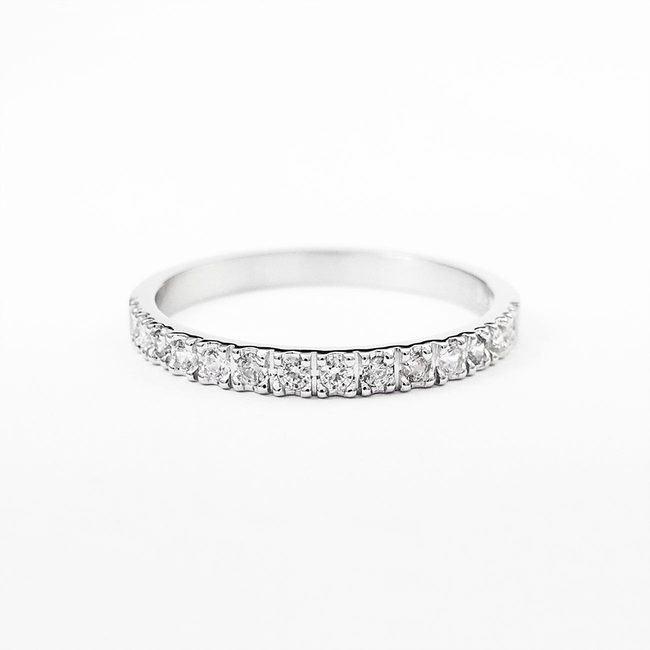 minimalist engagement ring with white diamonds