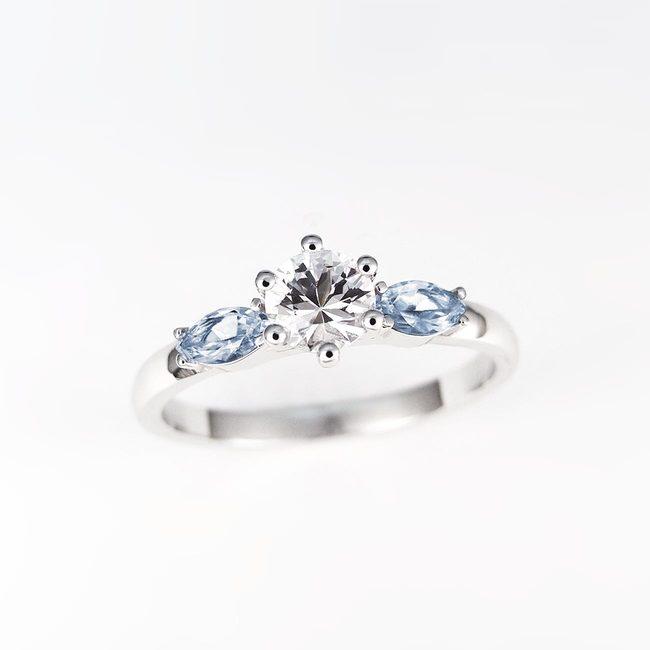 zaročni prstan osrednji kamen stranska spicasta okrogel špičast kombinacija cirkon topaz marquise