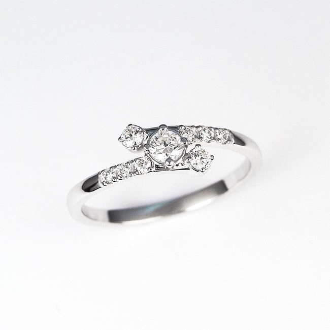 curved ring with diamonds engagement white gold