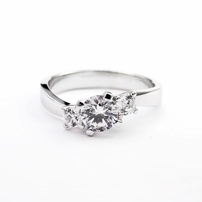 engagement ring curved design three stone