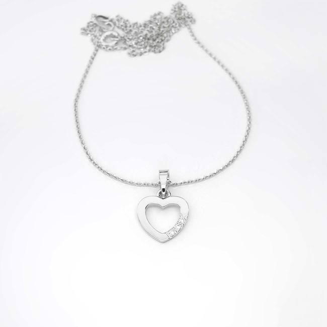 pendentif coeur or avec trois diamants or blanc