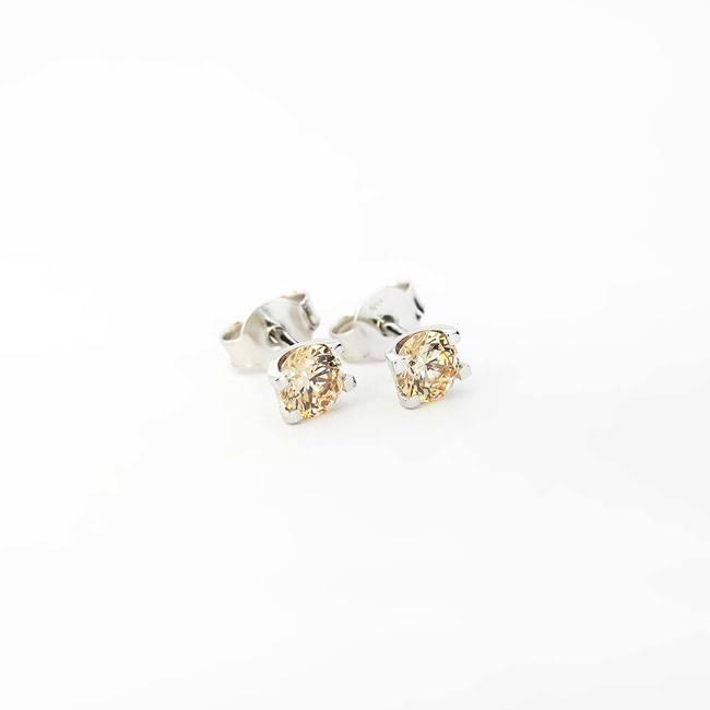 orecchini a bottone a forma di U in oro bianco con zirconi color champagne