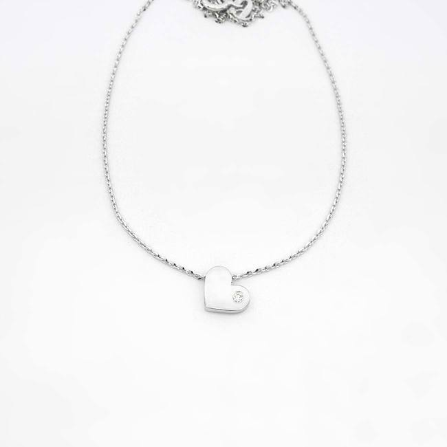 verižica in obesek minimalističen srček z diamantom belo zlato