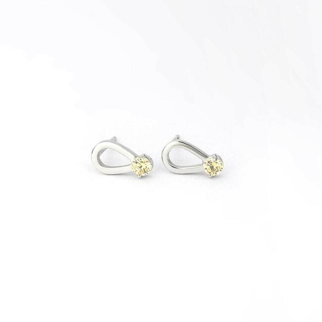 modern tear shaped stud earrings with stone white gold