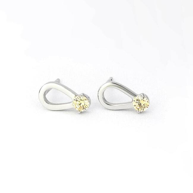 moderni uhani solzica zlato cirkoni diamanti