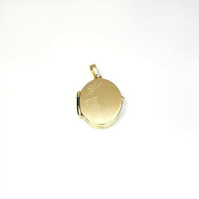 manjš̌i medaljon ovalne oblike z gravuro