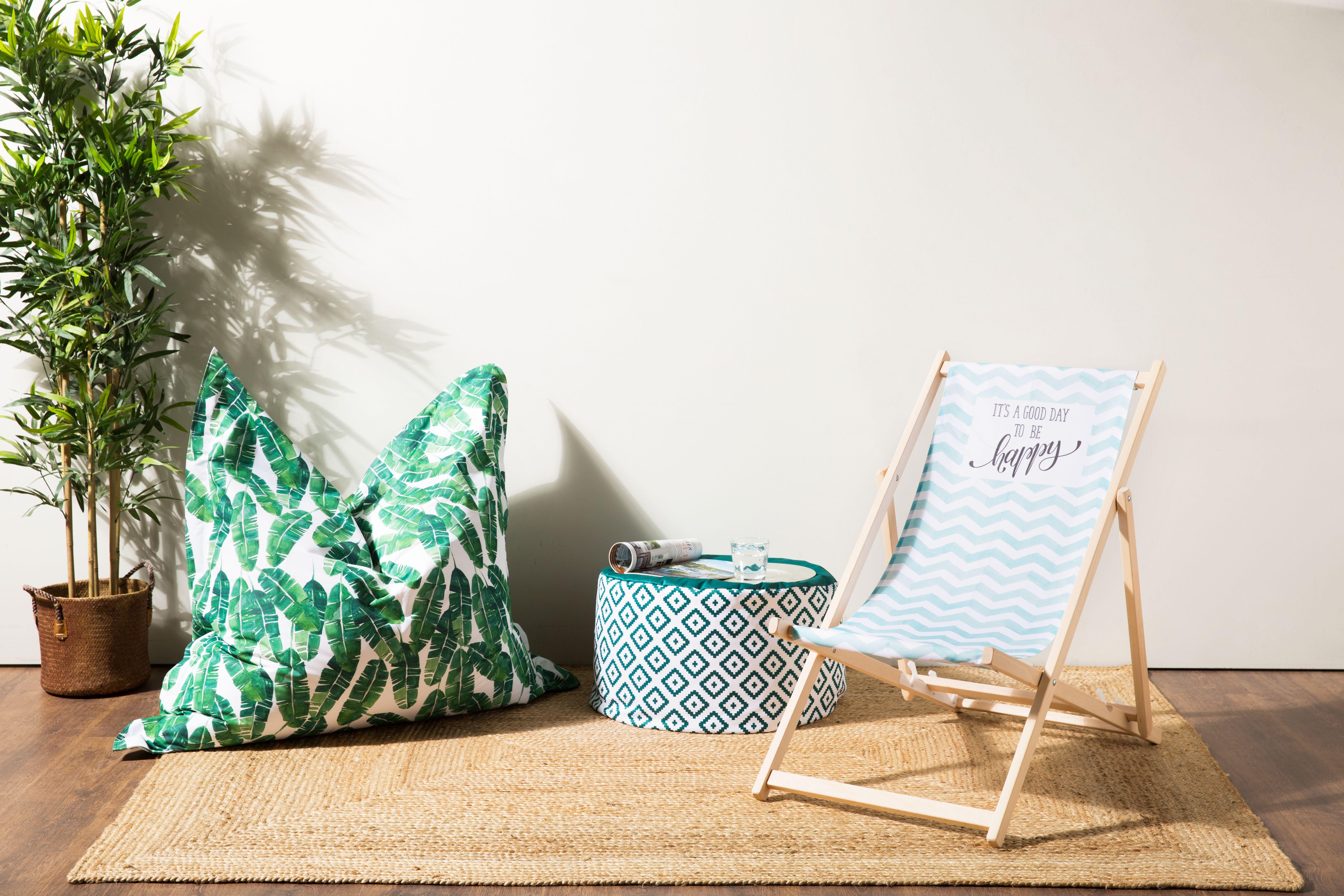 Strandstuhl mit Pflanze
