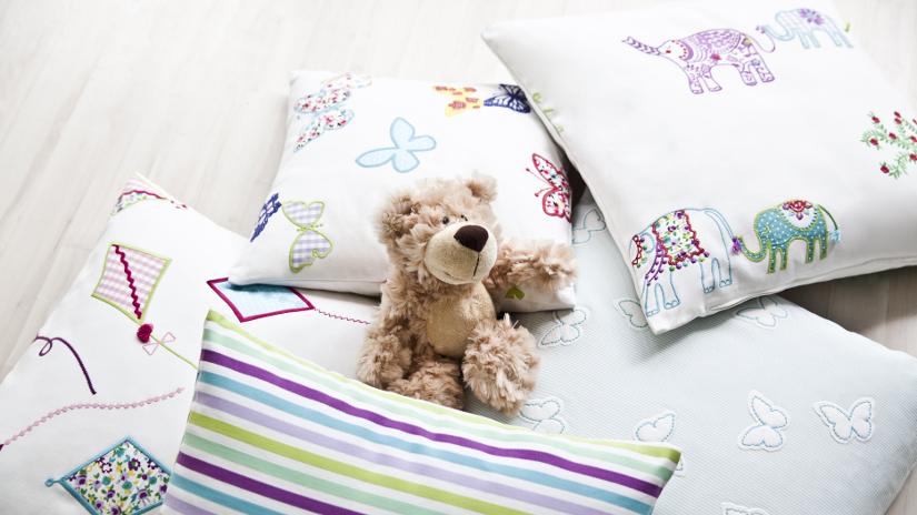 sábanas bordadas a mano para niños