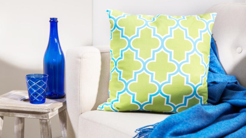 Coussin décoratif vert et bleu